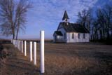 REL ANG MIS  MB  IAW1801235DST. PAUL'S ANGLICAN CHURCHBAIE ST. PAUL                      04© IAN A. WARD                    ALL RIGHTS RESERVEDANGLICAN;BAIE_ST_PAUL;CHURCHES;FENCES;MANITOBA;MB_;PLAINS;PRAIRIES;RELIGION;RURAL;SCENES;SPRING;ST_PAULS_ANGLICAN_CHURCH;STRUCTURESLONE PINE PHOTO              (306) 683-0889