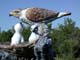 SCULPTURE OF FERRUGINOUS HAWK AND YOUNG IN NEST, LEADER