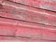 CLOSE UP OF WOOD GRAIN, WEATHERED RED PAINT, YORKTON