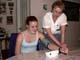 WOMAN DEMONSTRATING BLOOD PRESSURE TESTER ON GIRL, SALMON ARM