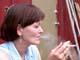 WOMAN SMOKING CIGARETTE, SASKATOON