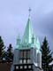 CHURCH STEEPLE AND STORM CLOUDS, BANFF