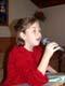 GIRL SPEAKING INTO MICROPHONE AT CHURCH, SASKATOON