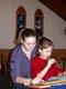 FEMALE SUNDAY SCHOOL TEACHER AND GIRL READING FROM BIBLE, SASKATOON