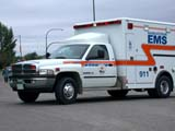 OCC AMB COM  SK  CWN02D2917DSIDE VIEW OF AMBULANCESASKATOON                          09/. .© CLARENCE W. NORRIS          ALL RIGHTS RESERVEDAMBULANCES;AUTOS;EMERGENCY_RESPONSE;OCCUPATIONS;PLAINS;PRAIRIES;SASKATCHEWAN;SASKATOON;SK_;SUMMER LONE PINE PHOTO                  (306) 683-0889