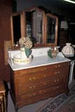 OCC ANT MIS  SK     1905217D  VTWHITE OAK DRESSER WITH WHITE MARBLE TOP IN ANTIQUE STORESASKATOON                       06                   © CLARENCE W. NORRIS      ALL RIGHTS RESERVEDANTIQUES;COLLECTIBLES;DRESSERS;FURNITURE;HISTORIC;OCCUPATIONS;PLAINS;PRAIRIES;RETAIL;SASKATCHEWAN;SASKATOON;SHOPPING;SK_;SPRING;VTLLONE PINE PHOTO              (306) 683-0889