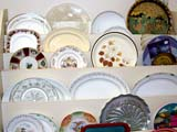 OCC ANT MIS  SK  CWN02D0111D                     DISPLAY OF OLD PLATES AND TRAYSSASKATOON                           07..© CLARENCE W NORRIS           ALL RIGHTS RESERVEDANTIQUES;CHINA;COLLECTIBLES;DISHES;OCCUPATIONS;PLAINS;PLATES;PRAIRIES;SASKATCHEWAN;SASKATOON;SHOPPING;SK_;TRAYS LONE PINE PHOTO                  (306) 683-0889