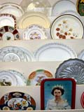 OCC ANT MIS  SK  CWN02D0112D  VTDISPLAY OF OLD PLATES AND TRAYSSASKATOON                           07..© CLARENCE W NORRIS           ALL RIGHTS RESERVEDANTIQUES;CHINA;COLLECTIBLES;DISHES;OCCUPATIONS;PLAINS;PLATES;PRAIRIES;SASKATCHEWAN;SASKATOON;SHOPPING;SK_;TRAYS;VTLLONE PINE PHOTO                  (306) 683-0889.