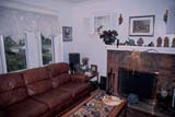 OCC BED BRE  SK     1902532DLIVING ROOM NINTH STREET BED AND BREAKFASTSASKATOON                       05                   © CLARENCE W. NORRIS      ALL RIGHTS RESERVEDACCOMODATIONS;BED_AND_BREAKFAST;FIREPLACES;FURNITURE;HOMES;NINTH_STREET_BED_AND_BREAKFAST;OCCUPATIONS;PLAINS;PRAIRIES;SASKATCHEWAN;SASKATOON;SK_;SUMMER;TOURISMLONE PINE PHOTO              (306) 683-0889