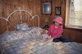 OCC BED BRE  SK     1903810D  MRGIRL AND TEDDY BEAR ON BEDCHAPLIN'S BED AND BREAKFAST                 FLORAL                              05                   © CLARENCE W. NORRIS      ALL RIGHTS RESERVEDACCOMODATIONS;BEARS;BED_AND_BREAKFAST;BEDROOMS;CHAPLINS_BED_AND_BREAKFAST;CHILDREN;FLORAL;HOMES;MR_;OCCUPATIONS;PEOPLE;PLAINS;PRAIRIES;SASKATCHEWAN;SK_;SUMMER;TEDDY;TOURISM;TOYSLONE PINE PHOTO              (306) 683-0889