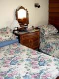 OCC BED BRE  SK  CWN02D0710D  VT BEDROOMSWIFT CURRENT HERITAGE BED AND BREAKFAST   SWIFT CURRENT                       07/02© CLARENCE W.  NORRIS          ALL RIGHTS RESERVEDBED_AND_BREAKFAST;BEDROOMS;BEDS;OCCUPATIONS;PLAINS;PRAIRIES;SASKATCHEWAN;SK_;SWIFT_CURRENT;SWIFT_CURRENT_HERITAGE_B_AND_B;TOURISM;VTLLONE PINE PHOTO                  (306) 683-0889