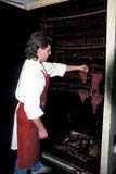 OCC BUT MIS  SK     1400108AD  VT  MRBUTCHER CHECKING BEEF JERKY DRYING IN OVENSASKATOON                       01                  © CLARENCE W. NORRIS      ALL RIGHTS RESERVEDBUTCHERS;FOOD;INDUSTRY;MALE;MEAT;MR_;OCCUPATIONS;PEOPLE;PLAINS;PRAIRIES;SASKATCHEWAN;SASKATOON;VTL;WINTERLONE PINE PHOTO              (306) 683-0889