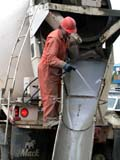 OCC CON COM  SK  CWN02D2921D  NMR  VT MAN WASHING CHUTE ON CEMENT TRUCKSASKATOON                           09/. .© CLARENCE W. NORRIS          ALL RIGHTS RESERVEDCEMENT;CLEANING;CONSTRUCTION;EQUIPMENT;INDUSTRY;MACHINERY;MALE;OCCUPATIONS;PEOPLE;PLAINS;PRAIRIES;SASKATCHEWAN;SASKATOON;SK_;VTLLONE PINE PHOTO                  (306) 683-0889