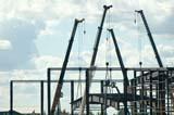 OCC CON COM  SK  WDS05B3222DX CRANES USED TO CONSTRUCT NEW SOCCER CENTERSASKATOON                     ....© WAYNE SHIELS               ALL RIGHTS RESERVEDCOMMERCIAL;CONSTRUCTION;CRANES;EQUIPMENT;OCCUPATIONS;PLAINS;PRAIRIES;SASKATCHEWAN;SASKATOON;SK_LONE PINE PHOTO              (306) 683-0889