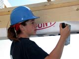 OCC CON RES  SK  CWN02D08907D  NMR      WOMAN STAPLING PAPER SEAL TO WINDOW FRAMESASKATOON HABITAT FOR HUMANITY - 2002SASKATOON                            07/16© CLARENCE W. NORRIS            ALL RIGHTS RESERVEDCARPENTRY;CONSTRUCTION;FEMALE;HABITAT_FOR_HUMANITY;HARD_HATS;HOMES;OCCUPATIONS;PEOPLE;PLAINS;PRAIRIES;RESIDENTIAL;SAFETY;SASKATCHEWAN;SASKATOON;SK_;VOLUNTEERSLONE PINE PHOTO                  (306) 683-0889