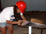 OCC CON RES  SK  CWN02D0928D   NMR WOMAN SAWING FOAM INSULATIONSASKATOON HABITAT FOR HUMANITY - 2002SASKATOON                            07/16© CLARENCE W. NORRIS            ALL RIGHTS RESERVEDCARPENTRY;CONSTRUCTION;FEMALE;HARD_HATS;OCCUPATIONS;PEOPLE;PLAINS;PRAIRIES;RESIDENTIAL;SAFETY;SASKATCHEWAN;SASKATOON;SAWING;SK_;TOOLS;VOLUNTEERSLONE PINE PHOTO                  (306) 683-0889