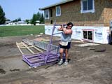 OCC CON RES  SK  CWN02D1076D  NMRWOMAN CARRYING METAL SCAFFOLDINGSASKATOON HABITAT FOR HUMANITY - 2002SASKATOON                            07/16© CLARENCE W. NORRIS            ALL RIGHTS RESERVEDABORIGINAL;CARPENTRY;CONSTRUCTION;FEMALE;HOMES;LADDERS;OCCUPATIONS;PEOPLE;PLAINS;PRAIRIES;RESIDENTIAL;SASKATCHEWAN;SASKATOON;SCAFFOLDING;SIDING;SK_;VOLUNTEERSLONE PINE PHOTO                  (306) 683-0889