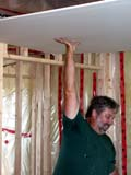 OCC CON RES  SK  CWN02D1326D  NMR  VT MAN INSTALLING DRYWALL ON CEILINGSASKATOON HABITAT FOR HUMANITY - 2002SASKATOON                           0721© CLARENCE W NORRIS           ALL RIGHTS RESERVEDCARPENTRY;CONSTRUCTION;DRYWALLING;HABITAT_FOR_HUMANITY;HOMES;MALE;OCCUPATIONS;PEOPLE;PLAINS;PRAIRIES;RESIDENTIAL;SASKATCHEWAN;SASKATOON;SK_;VOLUNTEERS;VTLLONE PINE PHOTO                  (306) 683-0889