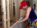 OCC CON RES  SK  CWN02D1380D  NMR WOMAN SMOOTHING EDGE OF DRYWALLSASKATOON HABITAT FOR HUMANITY - 2002SASKATOON                           0721© CLARENCE W NORRIS           ALL RIGHTS RESERVEDCARPENTRY;CONSTRUCTION;DRYWALLING;FEMALE;HABITAT_FOR_HUMANITY;OCCUPATIONS;PEOPLE;PLAINS;PRAIRIES;RESIDENTIAL;SASKATCHEWAN;SASKATOON;SK_;TOOLS;VOLUNTEERS;LONE PINE PHOTO                  (306) 683-0889.