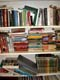 USED BOOKS PILED ON SHELF, SASKATOON