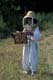 YOUNG GIRL HOLDING BEEHIVE, LA RIVIERE