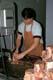 BUTCHER CUTTING PORK CHOPS, SASKATOON