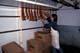 BUTCHER HANGING BACON IN WALK-IN COOLER, SASKATOON