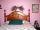 BED IN PINK BEDROOM, LUMSDEN