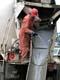 MAN WASHING CHUTE ON CEMENT TRUCK, SASKATOON