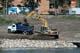 HEAVY-DUTY EQUIPMENT CONSTRUCTING RIVER LANDING, SASKATOON