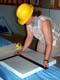 WOMAN MEASURING FOAM INSULATION, SASKATOON