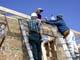 MEN ON LADDER WORKING ON ROOF, SASKATOON