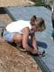 WOMAN SHINGLING ROOF, SASKATOON