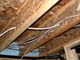 ELECTRICAL WIRING STRUNG THROUGH I-BEAM FLOOR JOISTS, SASKATOON