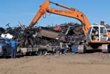 OCC SCR MET  SK     2111831DCRANE WITH CLAW LIFTING SCRAP METAL OFF TRAILERSASKATOON                       09                 © CLARENCE W. NORRIS      ALL RIGHTS RESERVEDAUTUMN;CLAWS;CRANES;EQUIPMENT;INDUSTRY;OCCUPATIONS;PLAINS;PRAIRIES;RECYCLING;SASKATCHEWAN;SASKATOON;SCRAP_METAL;SK_;STEELLONE PINE PHOTO              (306) 683-0889