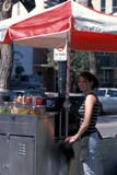 OCC STR VEN  SK  CWN0203011D  VTFEMALE STREET VENDOR AT HOT DOG STANDSASKATOON                       05                © CLARENCE W. NORRIS      ALL RIGHTS RESERVEDFEMALE;FOOD;HOT_DOGS;OCCUPATIONS;PEOPLE;PLAINS;PRAIRIES;SASKATCHEWAN;SASKATOON;SK_;STREET_VENDORS;SUMMER;VTLLONE PINE PHOTO              (306) 683-0889