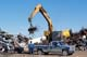 CRANE WITH ELECTROMAGNET LIFTING SCRAP OFF TRUCK, SASKATOON