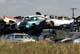 AUTOS PILED IN SCRAP METAL YARD, SASKATOON