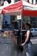 FEMALE STREET VENDOR AT HOT DOG STAND, SASKATOON