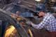 MAN CUTTING METAL WITH WELDING TORCH, SASKATOON
