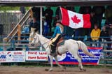 OCC ROD MIS  SK  WDS09B0642DXOPENING CEREMONY SASKATCHEWAN PROVINCIAL HIGH SCHOOL RODEO CHAMPIONSHIPOK CORRALMARTENSVILLE                        06© WAYNE SHIELS                    ALL RIGHTS RESERVEDACTIVITIES;ANIMALS;CANADIAN;COWGIRLS;FEMALE;FLAGS;HORSES;MARTENSVILLE;OCCUPATIONS;OK_CORRAL;OUTDOORS;PEOPLE;PLAINS;PRAIRIES;RIDING;RODEOS;SASKATCHEWAN;SASKATCHEWAN_PROVINCIAL_HIGH_SCHOOL_RODEO_CHAMPIONSHIP;SK_;SUMMER;TEENS;WESTERNLONE PINE PHOTO              (306) 683-0889