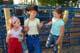 YOUNG GIRLS TALKING AT RODEO, WARMAN