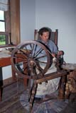 PAR HIS LOW  MB     1611877D  VTLADY SPINNING WOOLLOWER FT GARRY NAT HIST SITE   08/..                    © CLARENCE W. NORRIS              ALL RIGHTS RESERVEDBUILDINGS;FEMALE;FUR_TRADE;HISTORIC;HUDSONS_BAY_CO;LOWER_FORT_GARRY_NHS;MANITOBA;MB_;NATIONAL;PEOPLE;PIONEERS;PLAINS;PRAIRIES;SCENES;SPINNING;STRUCTURES;SUMMER;TOURISM;VTL;WOOLLONE PINE PHOTO              (306) 683-0889