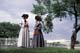 TWO LADIES VISITING ON LAWN, LOWER FORT GARRY NATIONAL HISTORIC SITE