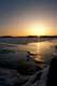 ICE ON WEKUSKO LAKE AT SUNRISE BEFORE SPRING BREAK, SNOW LAKE