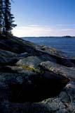 SEA SPR SCE  MB  BAE1000028D   VTSHORELINE OF SETTING LAKEWABOWDEN                        05/..                  © BRUCE A. ECKER               ALL RIGHTS RESERVEDBOREAL;LAKES;MANITOBA;MB_;ROCKS;SCENES;SETTING_LAKE;SHIELD;SHORELINE;SPRING;TREES;VTL;WABOWDEN;WATERLONE PINE PHOTO              (306) 683-0889