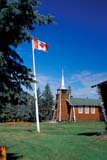 LOC COL MIS  NT  KJM0013710D  VTFLAG AND LOG CHURCHOUR LADY OF THE SNOWS CHURCHCOLVILLE LAKE                      08                   © KEVIN MORRIS                   ALL RIGHTS RESERVEDARCTIC;BUILDINGS;CANADIAN;CATHOLIC;CHURCHES;COLVILLE_LAKE;FLAGS;LOG_HOUSES;NORTHWEST;NORTHWEST_TERRITORIES;NT_;NWT;OUR_LADY_OF_THE_SNOWS_CHURCH;RELIGION;STRUCTURES;SUMMER;TERRITORIES;VTLLONE PINE PHOTO              (306) 683-0889