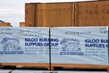 LOC COL MIS  NT  KJM0105417DBUILDING SUPPLIES CRATECOLVILLE LAKE                      05                   © KEVIN MORRIS                   ALL RIGHTS RESERVEDARCTIC;BANNERS;CO_OP;COLVILLE_LAKE;CONSTRUCTION;CRATES;HOMES;LUMBER;NORTHWEST;NORTHWEST_TERRITORIES;NT_;NWT;SIGNS;SUMMER;TERRITORIES;WOODLONE PINE PHOTO              (306) 683-0889