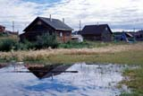 LOC FOR GOO  NT  KJM0012911DHOUSES REFLECTED IN PONDFORT GOOD HOPE                06                   © KEVIN MORRIS                   ALL RIGHTS RESERVEDARCTIC;BUILDINGS;FORT_GOOD_HOPE;HOMES;LOG_HOUSES;NORTHWEST;NORTHWEST_TERRITORIES;NT_;NWT;PONDS;REFLECTIONS;STRUCTURES;SUMMER;TERRITORIES;WATERLONE PINE PHOTO              (306) 683-0889