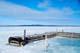 DOCK IN THAWING LAKE, COLVILLE LAKE